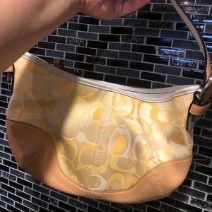 Yellow coach hand purse